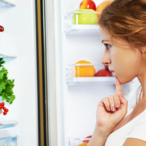 41614112 - happy woman standing at the open refrigerator with fruits, vegetables and healthy food